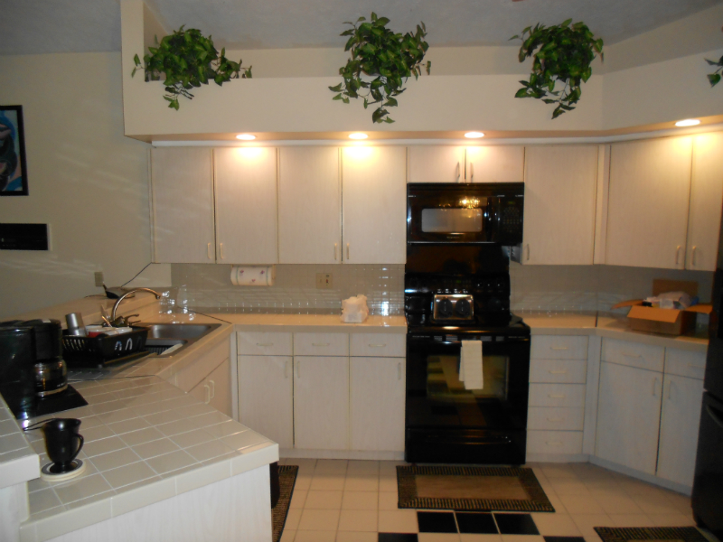 Include custom storage solutions with a kitchen remodel for Kitchen cabinets tampa